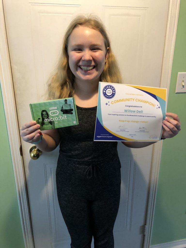 Willow holding her certificate